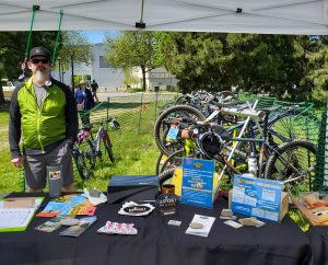 Member Joe Smith staffs the bike valet at the Siskiyou Velo booth at Siskiyou Challenge Health & Fitness Expo (ScienceWorks, April 27, 2019)